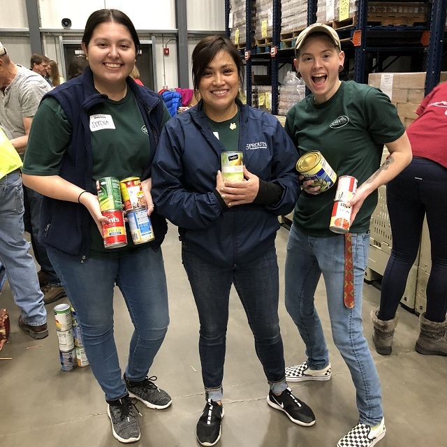 Sprouts team members volunteering at a food bank