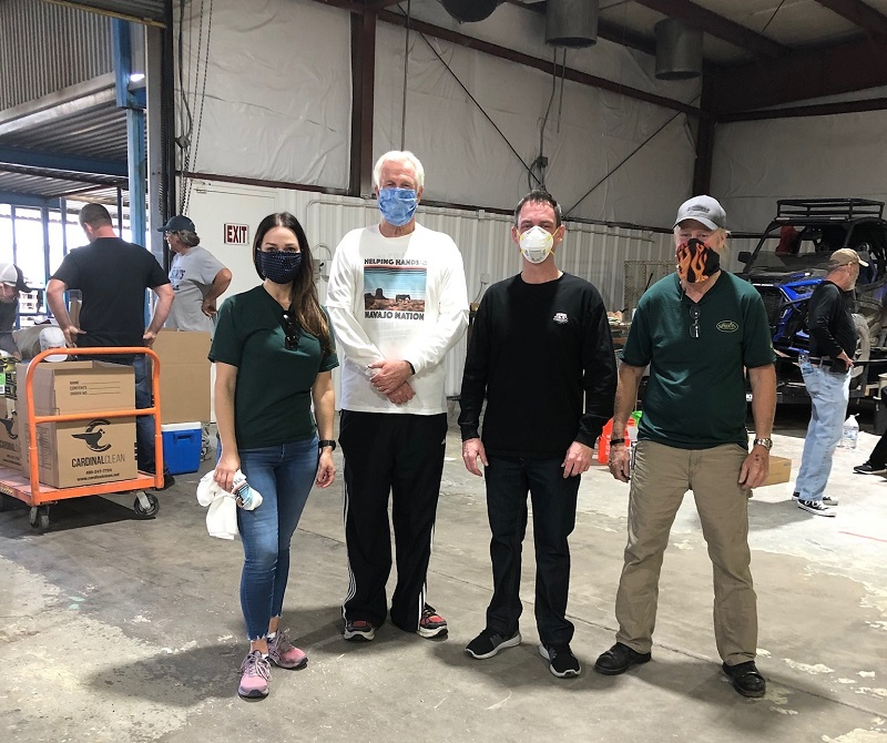 Four volunteers at distribution center warehouse